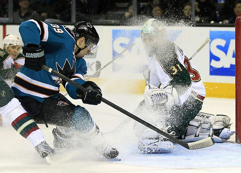 Minnesota Wild goalie Matt Hackett (31) stops a shot attempt from San Jose Sharks center Logan Couture (39) during the second period of an NHL hockey game in San Jose, Calif., Tuesday, Dec. 6, 2011. (AP Photo/Marcio Jose Sanchez)  Ran on: 12-07-2011 Matt Hackett stops Logan Couture's shot, along with the other 33 shots he faced. Photo: Marcio Jose Sanchez, AP