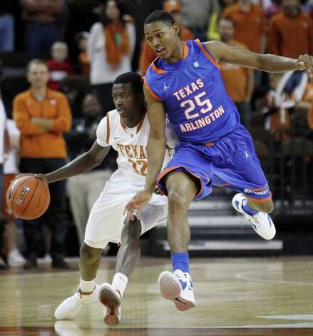 Texas' Myck Kabongo (12) is defended by Texas Arlington's Cameron Catlett (25) during the first half of an NCAA college basketball game, Tuesday, Dec. 6, 2011, in Austin. Photo: Eric Gay, Associated Press