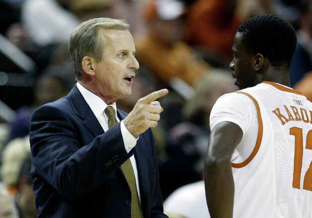 Texas coach Rick Barne, left, talks with  Myck Kabongo, right, during the second half of an NCAA college basketball game against Texas Arlington, Tuesday, Dec. 6, 2011, in Austin. Photo: Eric Gay, Associated Press