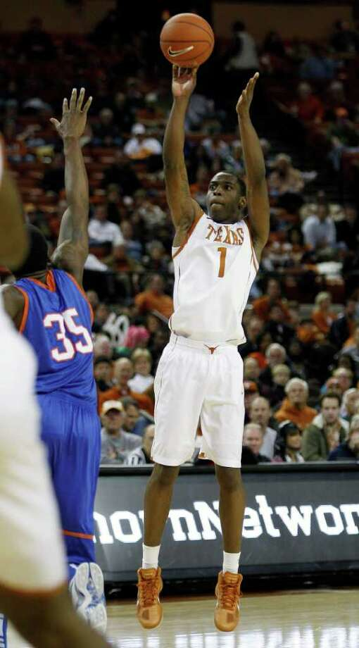 Texas' Sheldon McClellan (1) shoots as Texas Arlington's Brandon Edwards (35) during the second half of an NCAA college basketball game, Tuesday, Dec. 6, 2011, in Austin. Photo: Eric Gay, Associated Press