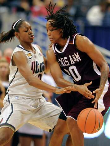 Connecticut's Tiffany Hayes, left, pressures Texas A&M's Tyra White, right in the first half of an NCAA college basketball game in Hartford, Conn., Tuesday, Dec. 6, 2011. Photo: Jessica Hill, Associated Press