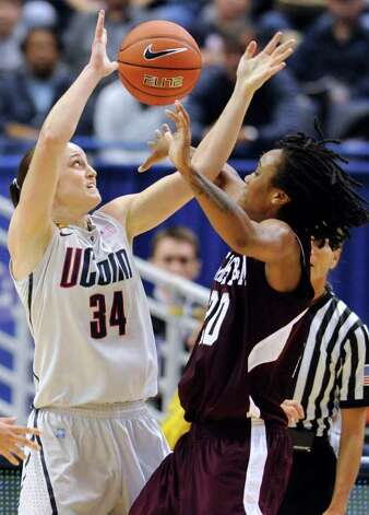 Connecticut's Kelly Faris, left, blocks a pass by Texas A&M's Tyra White in the first half of an NCAA college basketball game in Hartford, Conn., Tuesday, Dec. 6, 2011.  Connecticut won 81-51. Photo: Jessica Hill, Associated Press