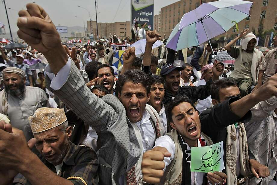 Anti-government protestors, shout slogans during a demonstration demanding the resignation of Yemeni President Ali Abdullah Saleh, in Sanaa, Yemen, Friday, July 1, 2011. Military officials say dozens of Yemeni officers suspected of turning against embattled President Ali Abdullah Saleh have been arrested under orders from his son. Photo: Hani Mohammed, AP