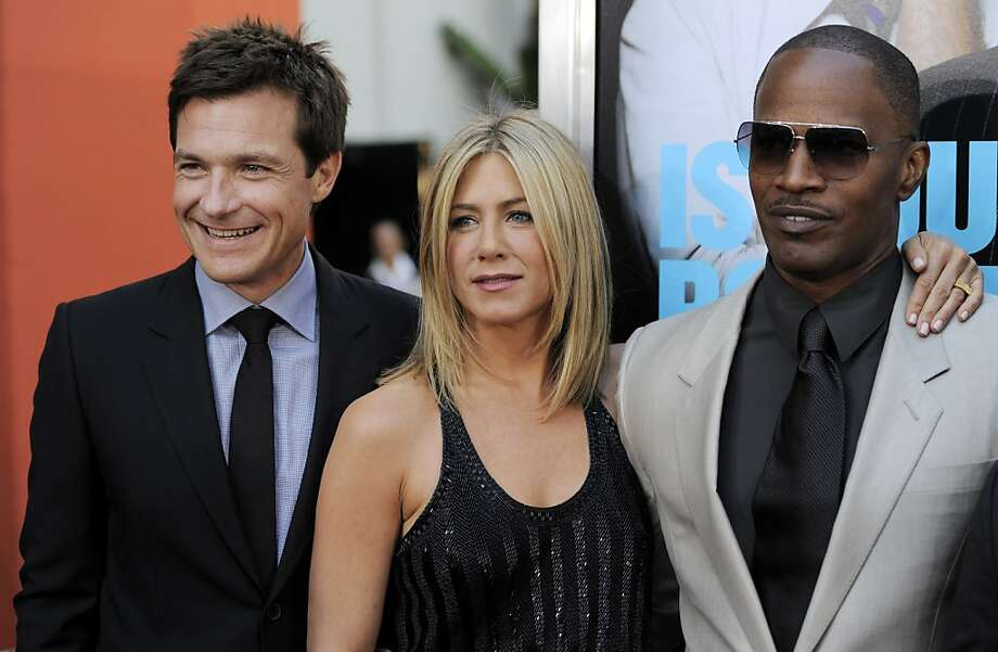 "Jason Bateman, left, Jennifer Aniston, center, and Jamie Foxx, cast members in ""Horrible Bosses,"" pose together at the premiere of the film, Thursday, June 30, 2011, in Los Angeles. The film is released on July 8. Photo: Chris Pizzello, AP"