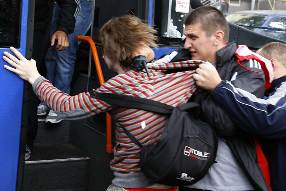 """Belarus plainclothes policemen detain a protester during an action """"Revolution via social network"""" in Minsk, Belarus, Wednesday, June 29, 2011. Police in Belarus have violently quashed a peaceful anti-government rally, detaining dozens of people protesting the authoritarian regime of President Alexander Lukashenko. Photo: Sergei Grits, AP"""
