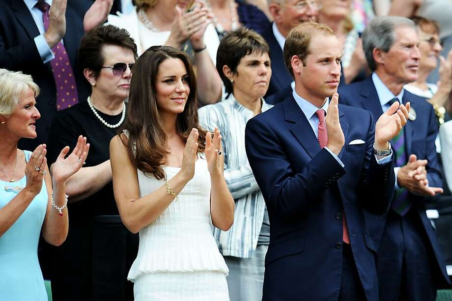 At Wimbledon 2011, Kate Middleton sports a tiered, white Alice Temperley dress, a tan clutch, nude pumps and a charm bracelet. Photo: Clive Mason, Getty Images