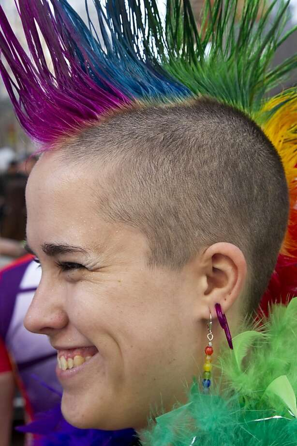 A reveler shows off her rainbow-hawk during the San Francisco Pride Parade 2011.  Photo: Ericsf7