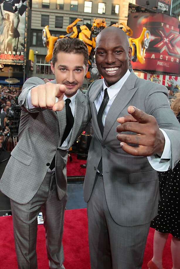 "In this photo provided by StarPix, Shia LaBeouf, left, and Tyrese Gibson, right, pose for photographs at the premiere of ""Transformers: Dark of the Moon"" Tuesday, June 28, 2011, in New York's Times Square. Photo: Dave Allocca, AP"