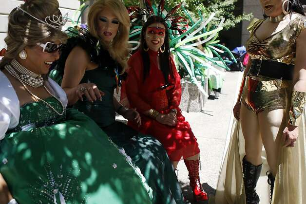 Participants in the annual San Francisco Pride parade wait for their turn to ...