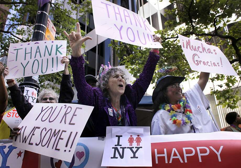 "SHelly Bailes, left and wife Ellen Pontac of Davis  stand and cheer with Maria Levy of North Carolina showing their support for New York's new ruling allow same sex marriages, as the San Francisco Pride Parade streams down Market Street, Sunday June 26, 2011, in San Francisco, Calif. The 41st Pride celebration and parade carried the theme of ""In Pride We Trust"" ,to commemorate and celebrate the history, culture and striving for equal rights. Photo: Lacy Atkins, The Chronicle"