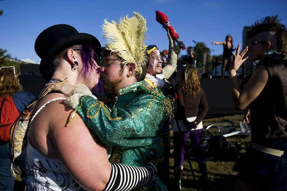 Alexis Nelson, left, and Sean Bug share a kiss before the Transgender March. The annual Transgender March started at Dolores Park on Friday, June 24 and ended at the U.N. Plaza. Hundreds of people showed up to support and participate in the march. Photo: Maddie McGarvey, The Chronicle