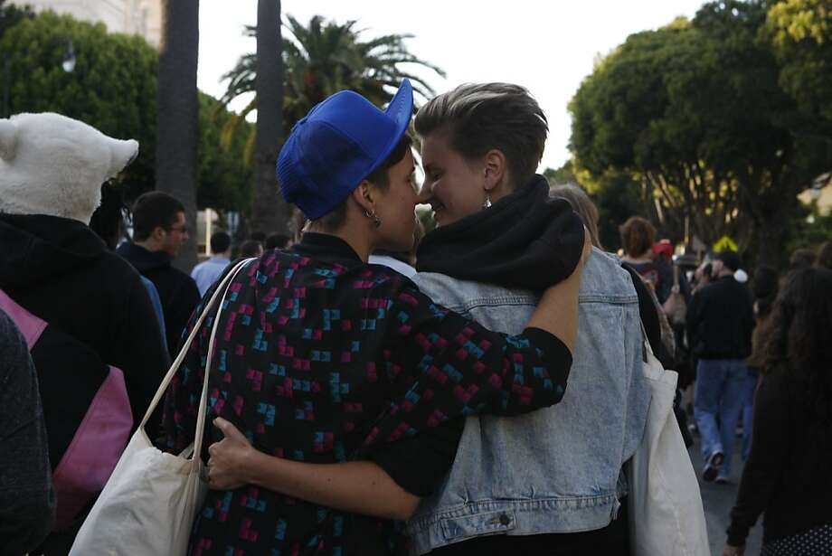 Participants in the Transgender March in San Francisco, Calif., share a kiss on Friday, June 24, 2011. Photo: Michelle Terris, The Chronicle