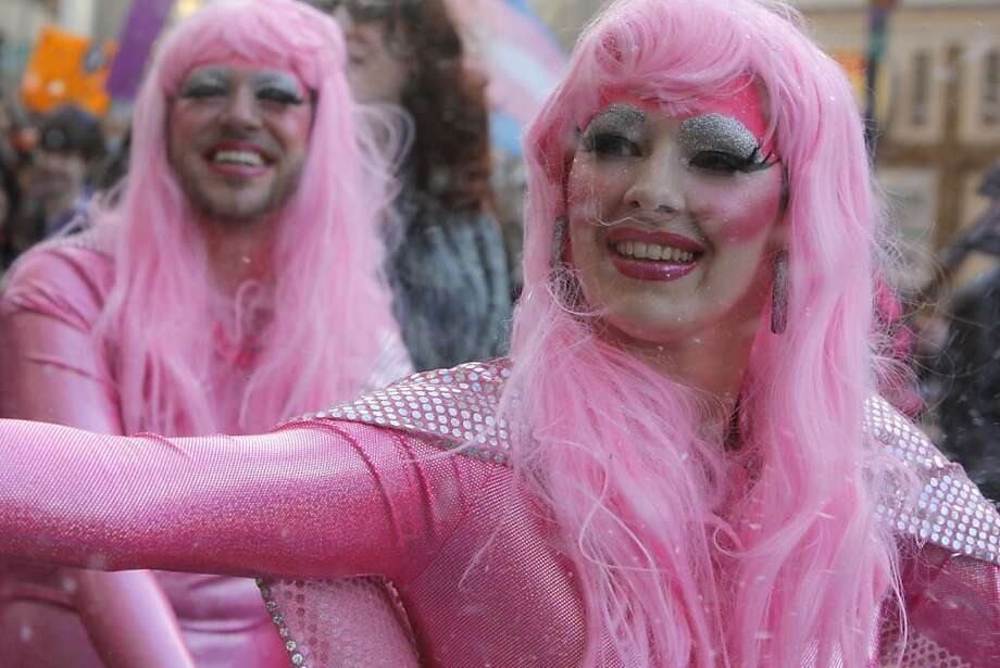 The glitter twins, Keith Murray, left, and Anthea Black ride down Market street in San Francisco, Calif., on Friday, June 24, 2011 during the Transgender March. Photo: Michelle Terris, The Chronicle