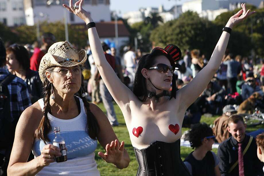 Robin Lerios and her daughter Adrian Valentine dance to music in Dolores Park for the 2011 San Francisco Transgender Parade. Photographed in San Francisco Calif.,  on June 24, 2011. Photo: Audrey Whitmeyer-Weathers, The Chronicle