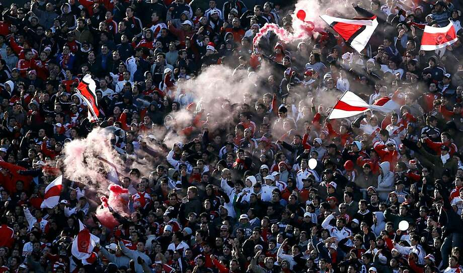 River Plate's soccer fans cheer before an Argentine promotion soccer game with Belgrano in Buenos Aires, Argentina, Sunday June 26, 2011.  River Plate must win Sunday's game against second-division Belgrano by two goals, or it will be playing in second division next season for the first time in the club's history. Photo: Natacha Pisarenko, AP