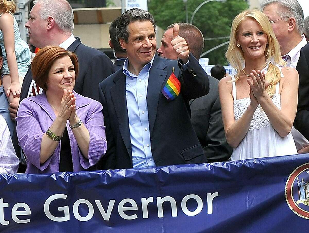 City Council Speaker Christine Quinn, Governor Andrew Cuomo and Cuomo's girlfriend Sandra Lee, left to right, walk in the annual Heritage of Pride March, one of the world's oldest and largest gay pride parades, Sunday June 26, 2011, in New York. The parade became a victory celebration after New York's historic decision to legalize same-sex marriage on Friday.