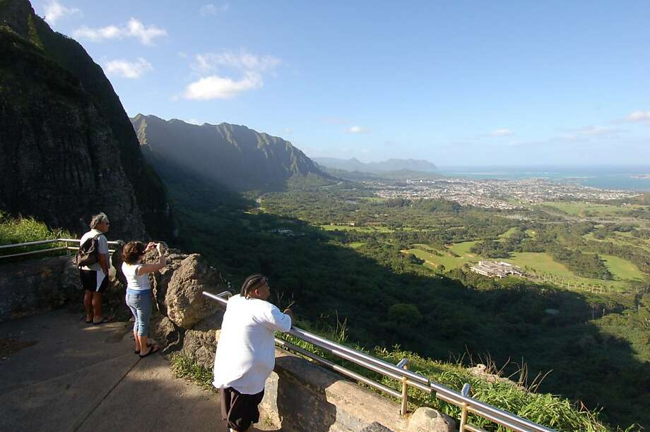 The Nu'uanu Pali lookout provides an inexpensive history lesson, panoramic view and convenient pit stop on the way to Windward Side beaches. Photo: Jeanne Cooper, Special To SFGate