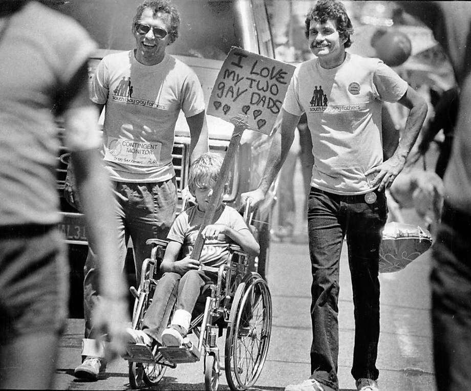 Two South Bay fathers walk with their son during the 1983 Gay Pride PArade. June 26, 1983. Photo: Eric Luse, The Chronicle