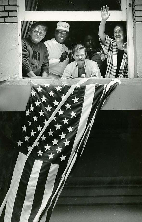Spectators watch the 1987 Gay Pride Parade from a Market Street hotel room. Photo taken June 28, 1987. Photo: Tom Levy, The Chronicle