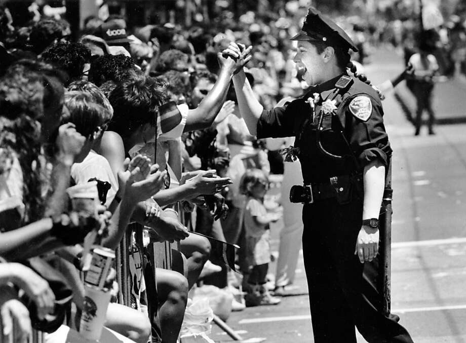 San Francisco police officer Lee Nyder shakes hands with a friend in the crowd during the 1991 Gay Pride Parade. She was marching with a gay and lesbian police contingent. June 30, 1991.San Francisco police officer Lee Nyder shakes hands with a friend in the crowd during the 1991 Gay Pride Parade. She was marching with a gay and lesbian police contingent. June 30, 1991. Photo: Brant Ward, The Chronicle