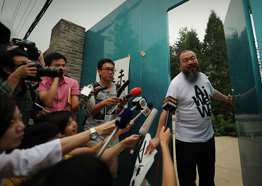 Outspoken Chinese artist Ai Weiwei (R) arrives to speak to reporters outside his studio in Beijing on June 23, 2011.  Human rights groups and Western officials welcomed the release on bail of Ai Weiwei but voiced dismay about the conditions and urged Beijing to free other activists. PHOTO/Peter PARKS (Photo credit should read PETER PARKS/AFP/Getty Images) Photo: Peter Parks, AFP/Getty Images