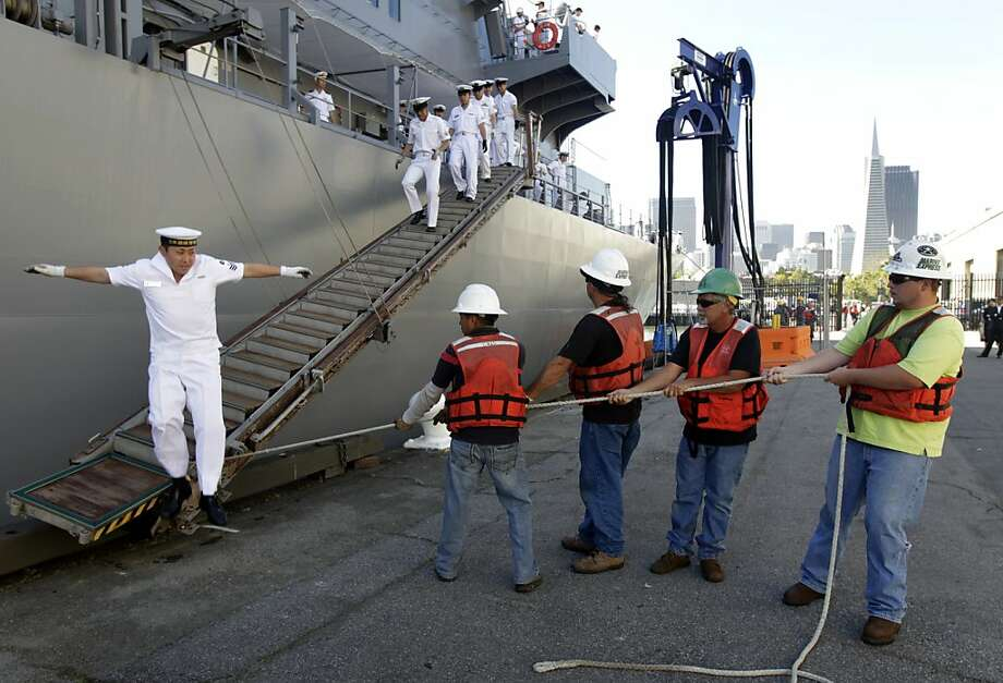 A crewman leaps from a gangway to assist dockworkers move it into place after the Japanese Maritime Self-Defense Force ship Kashima docked at Pier 27 in San Francisco, Calif. on Tuesday, June 21, 2011. The training vessel made its third port call on its six country, 156-day goodwill training cruise and will visit 14 cities. Photo: Paul Chinn, The Chronicle