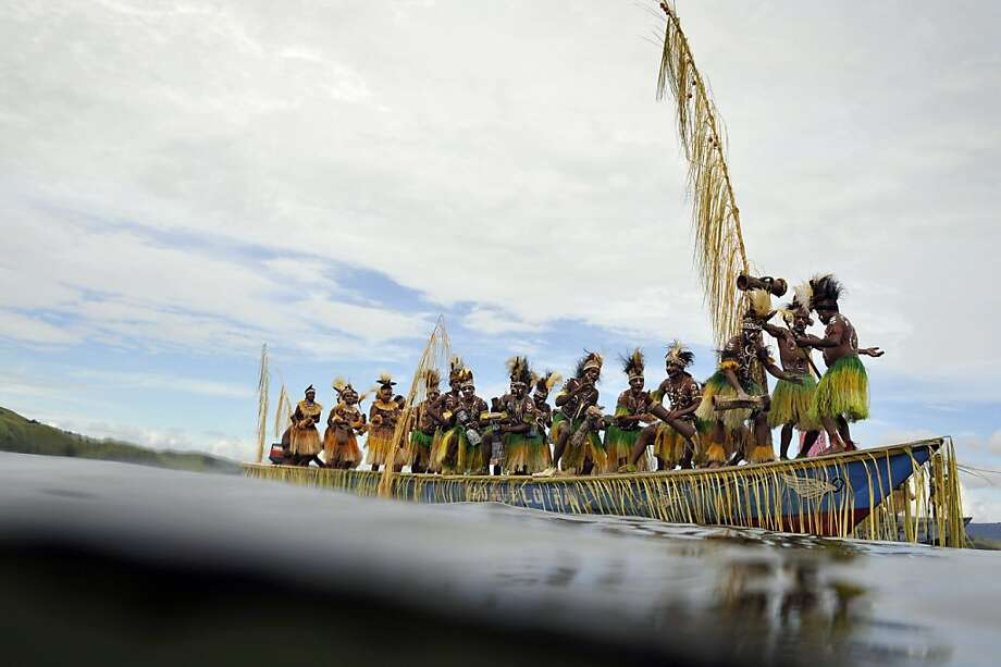 This photo taken on June 20, 2011 shows Papuan tribe members riding a ceremonial boat on Lake Sentani during the Lake Sentani Festival close to the city of Jayapura, located in Indonesia's eastern Papua province. The five-day annual festival is a celebration of Papua's diverse ethnic culture and heritage while at the same time give hommage to Papua's largest pristine lake that is a source of food and livelihood to the population. Photo: Romeo Gacad, AFP/Getty Images