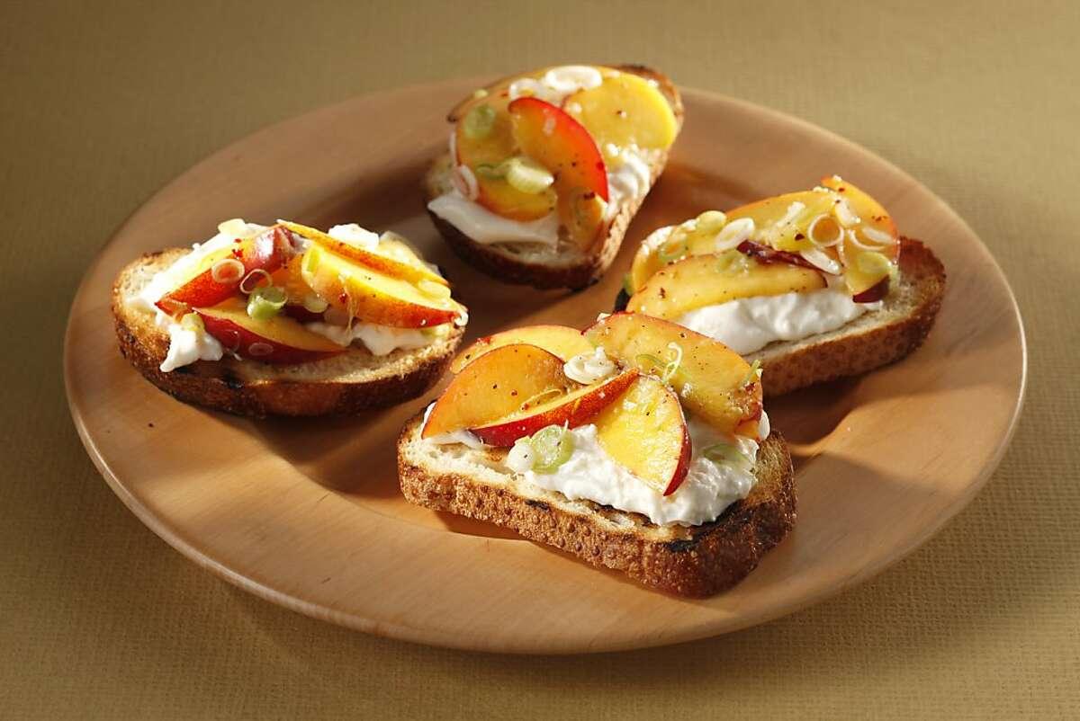 Peach Crostini With Stracciatella. Food styled by Sophie Brickman.