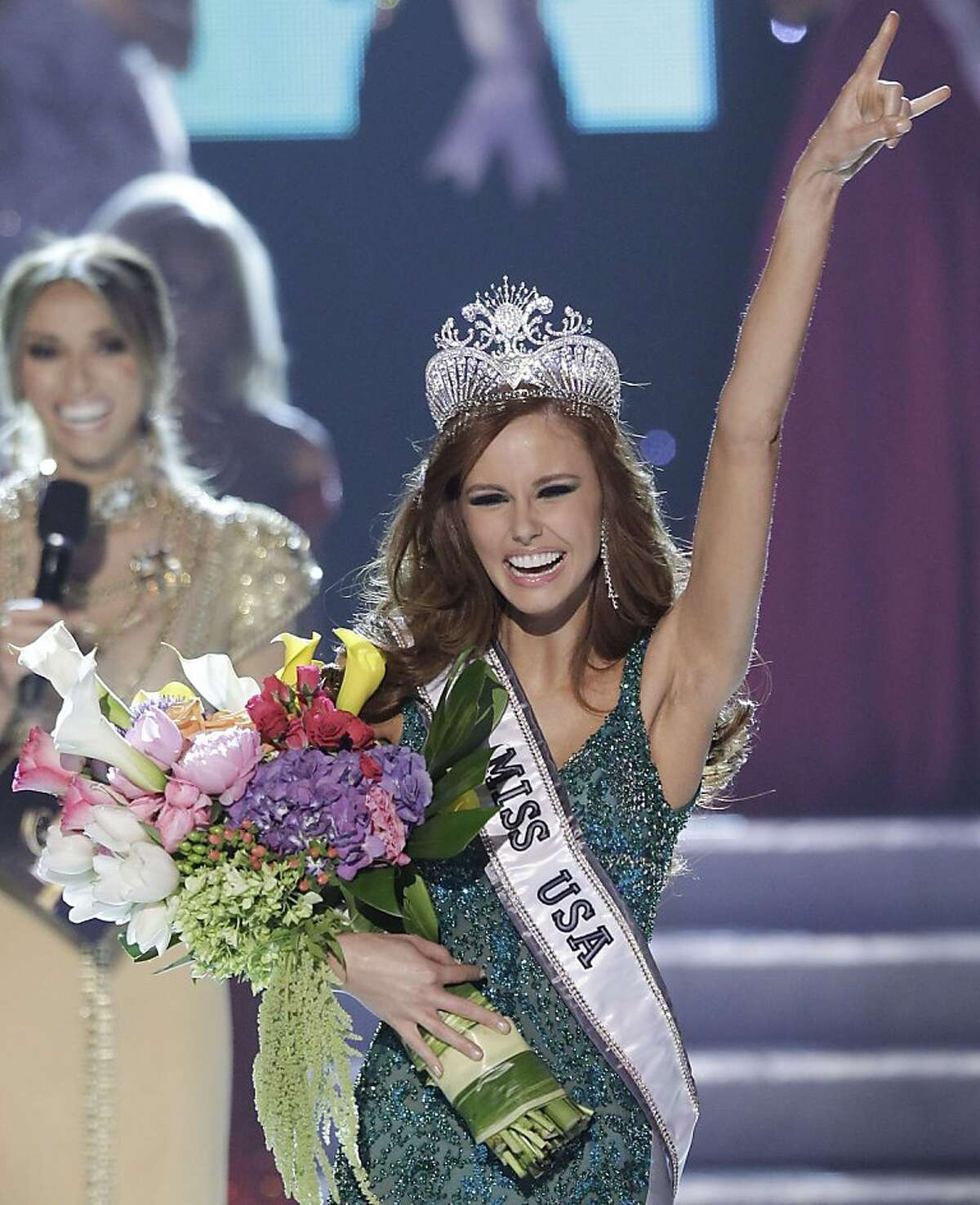 Alyssa Campanella, Miss California, reacts after being crowned the 2011 Miss USA, Sunday, June 19, 2011, in Las Vegas.