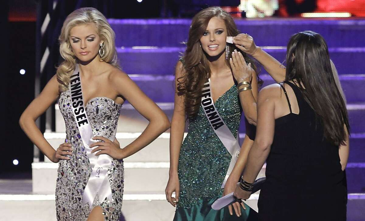 Alyssa Campanella, Miss California,, right, has her make-up touched up as Ashley Elizabeth Durham, Miss Tennessee, waits her turn during a break at the 2011 Miss USA pageant, Sunday, June 19, 2011, in Las Vegas.