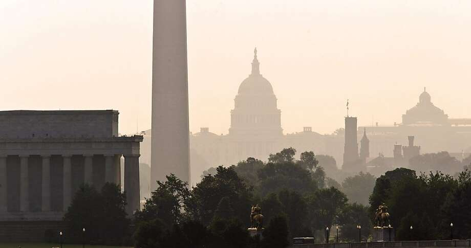 The monuments of Washington are silhouetted in the haze and high humidity as steamy weather blankets the nation's capitol, as viewed from Arlington, Va., Friday, June, 2011. From left are the Lincoln Memorial, Washington Monument, the Capitol, the Smithsonian Castle, and the Library of Congress. Photo: J. Scott Applewhite, AP