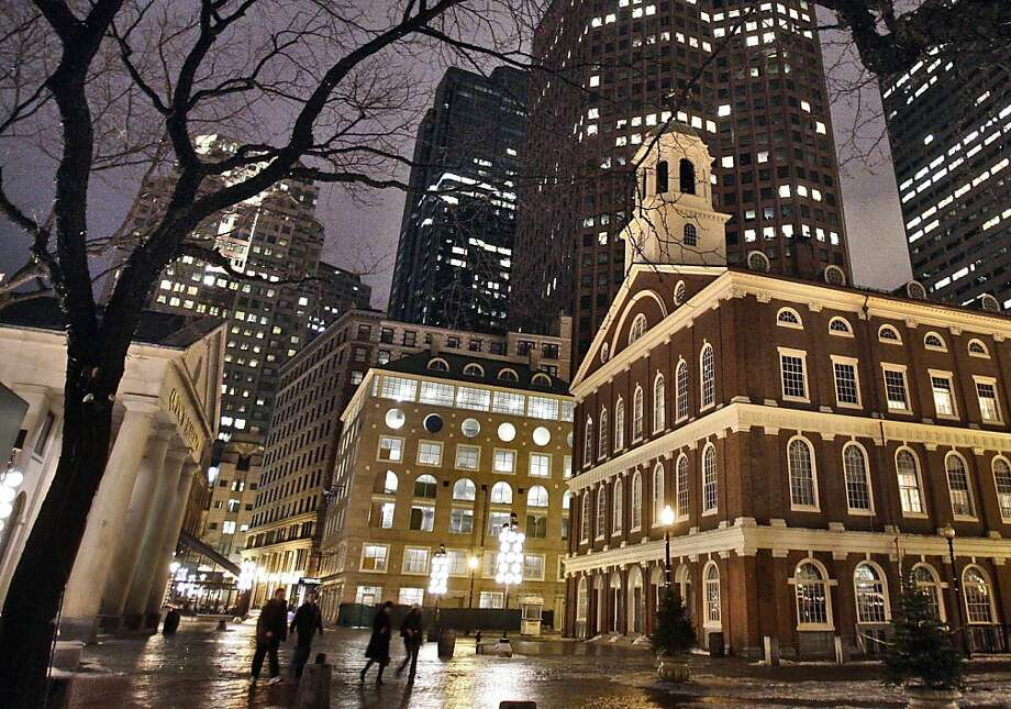 In this Feb. 22, 2007 file photo, Faneuil Hall, right, is seen at night among the buildings in downtown in Boston. Faneuil Hall is one of the historic sites on Boston's Freedom Trail.  (AP Photo/Michael Dwyer) Photo: Michael Dwyer, AP
