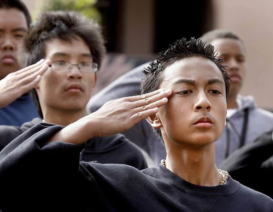 JROTC cadet Jed Alimbuyuguen salutes his training officer at the end of a drill practice. The JROTC programs in San Francisco, like the longtime Balboa High School group,  are in danger of being eliminated. Photo: Brant Ward, The Chronicle