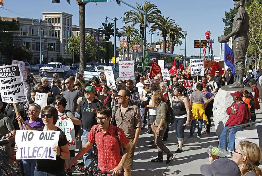 """Protestors outside AT&T Park join in the """"National Day of Action Against SB1070""""  by picketing the Arizona Diamondbacks vs. San Francisco Giants baseball game  Saturday, May 29, 2010, in San Francisco. The protest was held in support of the Boycott Arizona campaign. Photo: Ben Margot, AP"""
