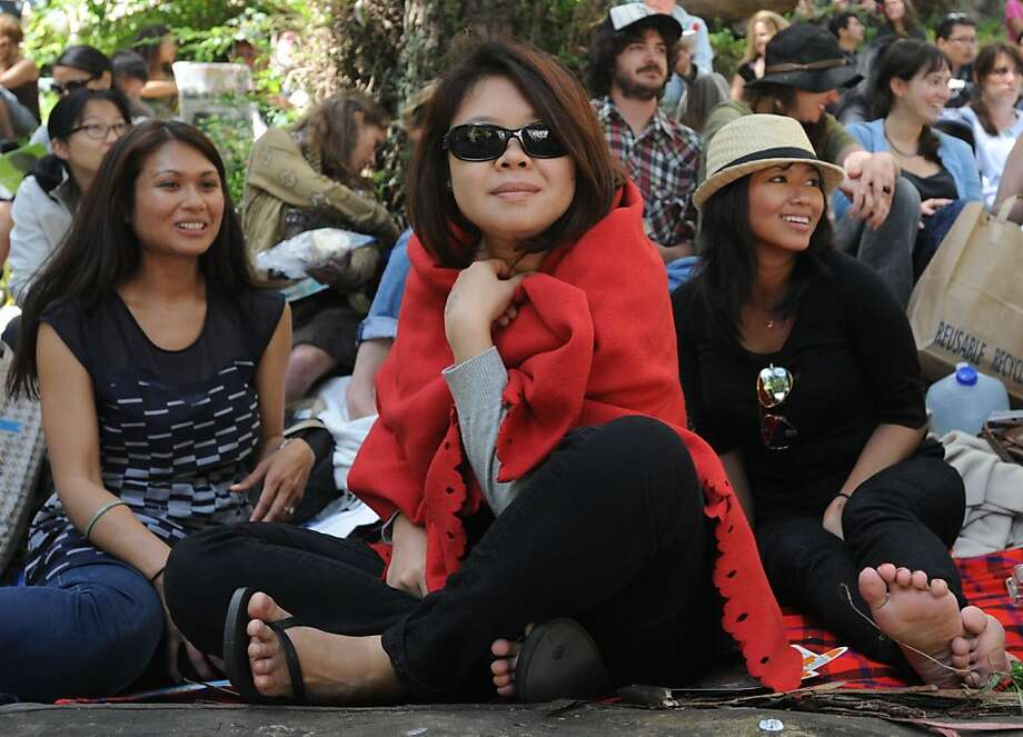 From left: Ezmeera Hansen, May Chong, and Jake Pandile are seen at Stern Grove which kicked off their 74th season of admission free concerts on June 19, 2011. Photo: Susana Bates, Special To The Chronicle