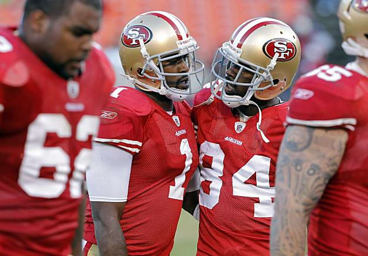 Josh Morgan gives Troy Smith, left, a little encouragement in the fourth quarter against the Tampa Bay Buccaneers at Candlestick Park in San Francisco on Sunday.