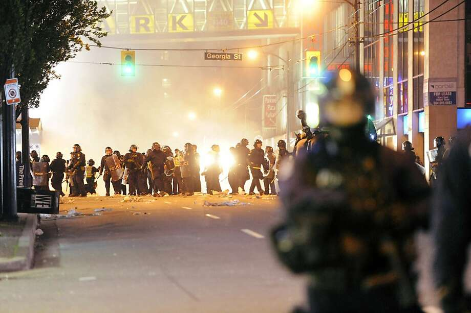 Riot police walk in the street on June 15, 2011 in Vancouver, Canada. Vancouver broke out in riots after their hockey team the Vancouver Canucks lost in Game Seven of the Stanley Cup Finals. Photo: Rich Lam, Getty Images