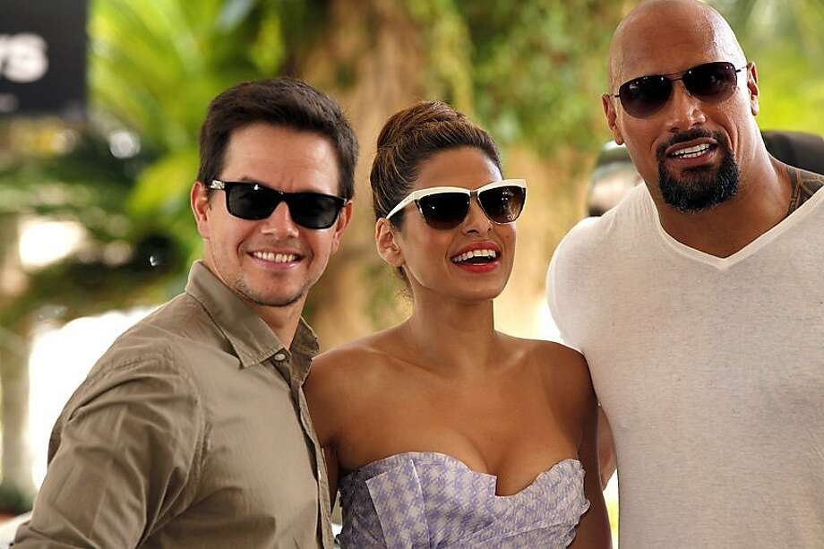 Cancun, Mexico - June 28, 2010: Mark Wahlberg, Eva Mendes and Dwayne Johnson at Columbia Pictures' THE OTHER GUYS Photo Call held at Summer of Sony. Photo: Courtesey Cancun CVB
