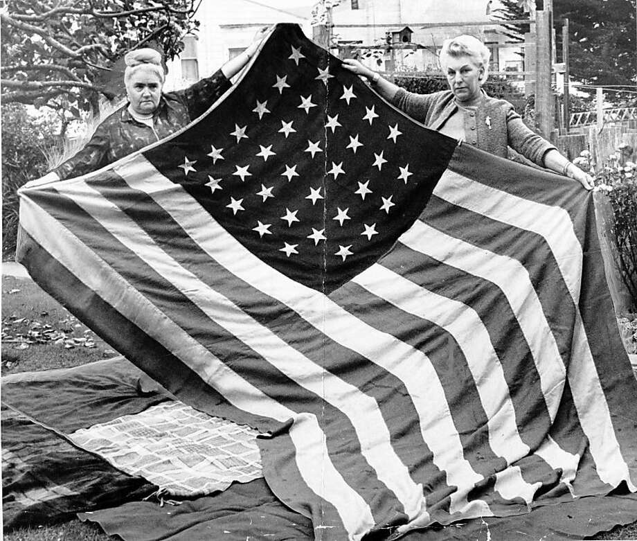 L to R: Mrs. Therese Gysenberg, Mrs. Jane Park and U.S. flag from the Lincoln era.  November 3, 1966. Photo by Joseph J. Rosenthal. Photo: Joe Rosenthal, The Chronicle