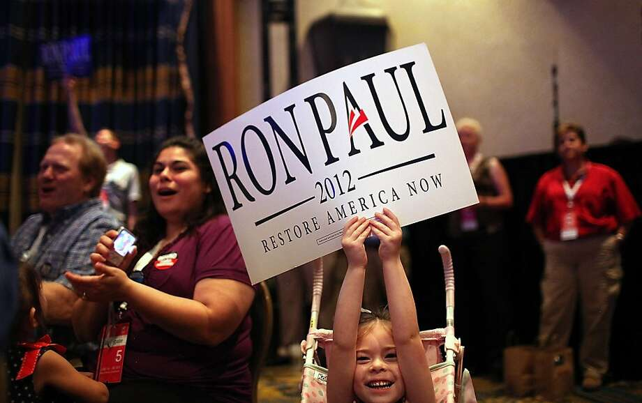 Supporters of Republican presidential candidate U.S. Rep. Ron Paul (R-TX) cheer as he speaks during the 2011 Republican Leadership Conference on June 17, 2011 in New Orleans, Louisiana. The 2011 Republican Leadership Conferenceruns through tomorrow and will feature keynote addresses from most of the major Republican candidates for president as well as numerous Republican leaders from across the country. Photo: Justin Sullivan, Getty Images