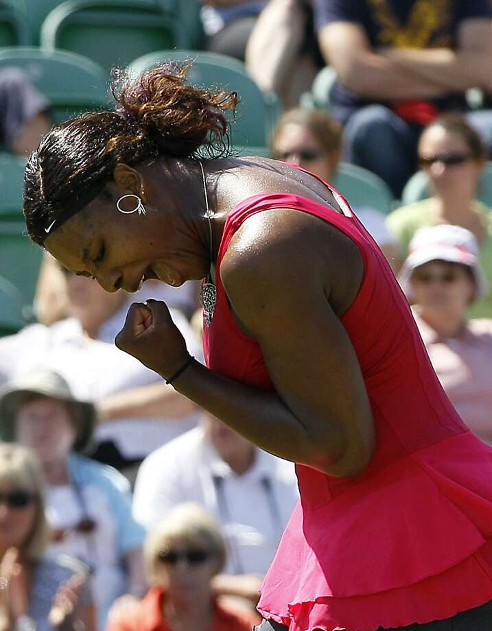 Serena Williams of the U.S. reacts during her singles tennis match against Tsvetana Pironkova of Bulgaria at the Eastbourne International grass court tennis tournament in Eastbourne, England,Tuesday, June 14, 2011. Photo: Kirsty Wigglesworth, AP