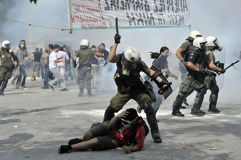 Protestors clash with riot police on June 15, 2011 during a demonstration near the parliament in the center of Athens. Thousands of demonstrators besieged the Greek parliament on June 15 in a large anti-austerity protest marred by violence, leaving at least a dozen injured ahead of a critical reform vote in parliament. Photo: Aris Messinis, AFP/Getty Images