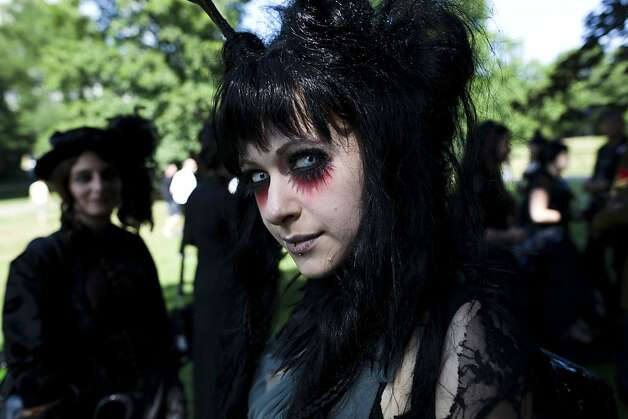 A costumed woman stays in a park during the annual Wave Gotik music festival on June 11, 2011 in Leipzig, Germany. The festival began in the 1990s and has since grown into one of the biggest gatherings of Goth scene followersin Europe with around 20,000 participants. Many of those attending wear elaborate outfits and make-up for which they require hours of painstaking preparation and that also show a departure from the traditional black of the Goth scene. Punk remains a strong influence in today«s Goth style as witnessed in Leipzig, but newer trends, with names like Cybergoth and Steampunk, have emerged that blend bold colors, Victorian fashion elegance and 19th and 20th century factory accessories into a look reminiscent Photo: Carsten Koall, Getty Images