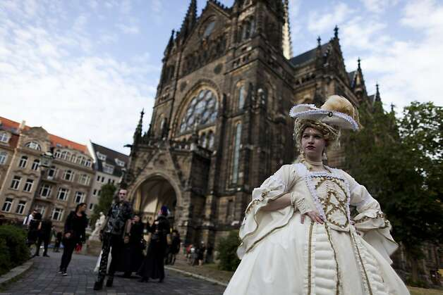 Gothic enthusiasts stand in front of a church after a classic concert during the annual Wave Gotik music festival on June 11, 2011 in Leipzig, Germany. The festival began in the 1990s and has since grown into one of the biggest gatherings of Goth scene followers in Europe with around 20,000 participants. Many of those attending wear elaborate outfits and make-up for which they require hours of painstaking preparation and that also show a departure from the traditional black ofthe Goth scene. Punk remains a strong influence in today«s Goth style as witnessed in Leipzig, but newer trends, with names like Cybergoth and Steampunk, have emerged that blend bold colors, Victorian fashion elegance and 19th and 20th century factory Photo: Carsten Koall, Getty Images
