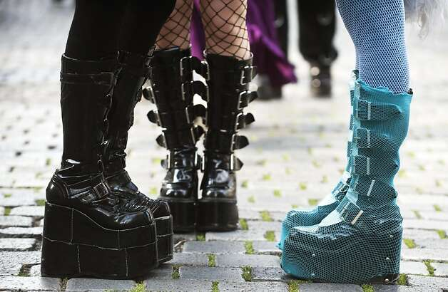 "Close up of boots worn by visitors to the wave-gothic meeting in downtown Leipzig, eastern Germany June 11, 2011. Organisers expect some 20,000 visitors from all over the world for the ""dark"" music and arts festival running from June 9 to 13, 2011. Photo: John MacDougall, AFP/Getty Images"