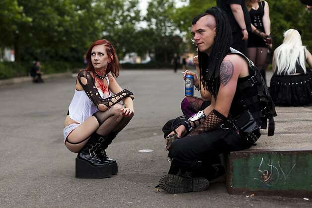 Gothic rock music enthusiasts make a break during the annual Wave Gotik music festival on June 11, 2011 in Leipzig, Germany. The festival began in the 1990s and has since grown into one of the biggest gatherings of Goth scene followers in Europe with around 20,000 participants. Many of those attending wear elaborate outfits and make-up for which they require hours of painstaking preparation and that also show a departure from the traditional black of the Goth scene. Punk remains a strong influence in today's Goth style as witnessed in Leipzig, but newer trends, with names like Cybergoth and Steampunk, have emerged that blend bold colors, Victorian fashion elegance and 19th and 20th century factory accessories. Photo: Carsten Koall, Getty Images