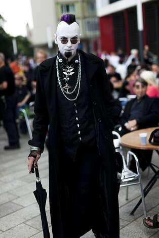 A Gothic rock music enthusiast walks on the street during the annual Wave Gotik music festival on June 11, 2011 in Leipzig, Germany. The festival began in the 1990s and has since grown into one of the biggest gatherings of Goth scene followers in Europe with around 20,000 participants. Many of those attending wear elaborate outfits and make-up for which they require hours of painstaking preparation and that also show a departure from the traditional black of the Goth scene. Punk remains a strong influence in todays Goth style as witnessed in Leipzig, but newer trends, with names like Cybergoth and Steampunk, have emerged that blend bold colors, Victorian fashion elegance and 19th and 20th century factory accessories into a l Photo: Carsten Koall, Getty Images