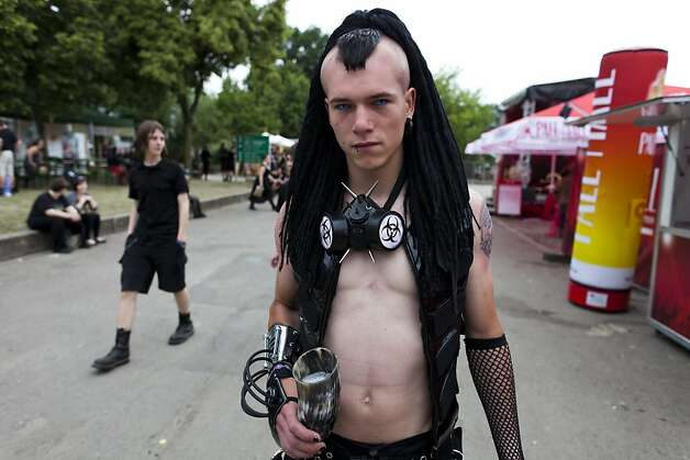 A Gothic rock music enthusiast walks the streets between venues during the annual Wave Gotik music festival on June 11, 2011 in Leipzig, Germany. The festival began in the 1990s and has since grown into one of the biggest gatherings of Goth scene followers in Europe with around 20,000 participants. Many of those attending wear elaborate outfits and make-up for which they require hours of painstaking preparation and that also show a departure from the traditional black of the Goth scene. Punk remains a strong influence in today's Goth style as witnessed in Leipzig, but newer trends, with names like Cybergoth and Steampunk, have emerged that blend bold colors, Victorian fashion elegance and 19th and 20th century factory access Photo: Carsten Koall, Getty Images
