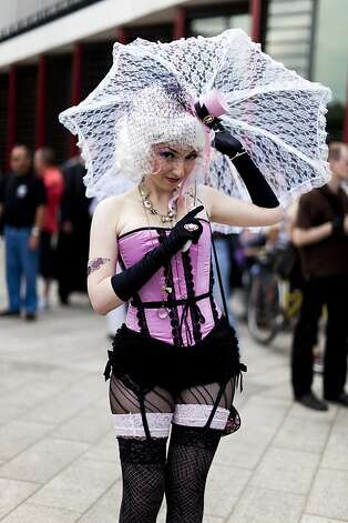 A costumed woman walks the streets between venues during the annual Wave Gotik music festival on June 11, 2011 in Leipzig, Germany. The festival began in the 1990s and has since grown into one of the biggest gatherings of Gothscene followers in Europe with around 20,000 participants. Many of those attending wear elaborate outfits and make-up for which they require hours of painstaking preparation and that also show a departure from the traditional black of the Goth scene. Punk remains a strong influence in today's Goth style as witnessed in Leipzig, but newer trends, with names like Cybergoth and Steampunk, have emerged that blend bold colors, Victorian fashion elegance and 19th and 20th century factory accessories into a l Photo: Carsten Koall, Getty Images