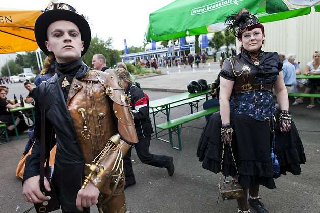 Gothic rock music enthusiasts walk the streets between venues during the annual Wave Gotik music festival on June 11, 2011 in Leipzig, Germany. The festival began in the 1990s and has since grown into one of the biggest gatherings of Goth scene followers in Europe with around 20,000 participants. Many of those attending wear elaborate outfits and make-up for which they require hours of painstaking preparation and that also show a departure from the traditional black of the Goth scene. Punk remains a strong influence in today's Goth style as witnessed in Leipzig, but newer trends, with names like Cybergoth and Steampunk, have emerged that blend bold colors, Victorian fashion elegance and 19th and 20th century factory accessor Photo: Carsten Koall, Getty Images
